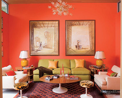 Loosley a split-complementary red orange, red-violet, and green (though the couch is really more of a yellow-green)