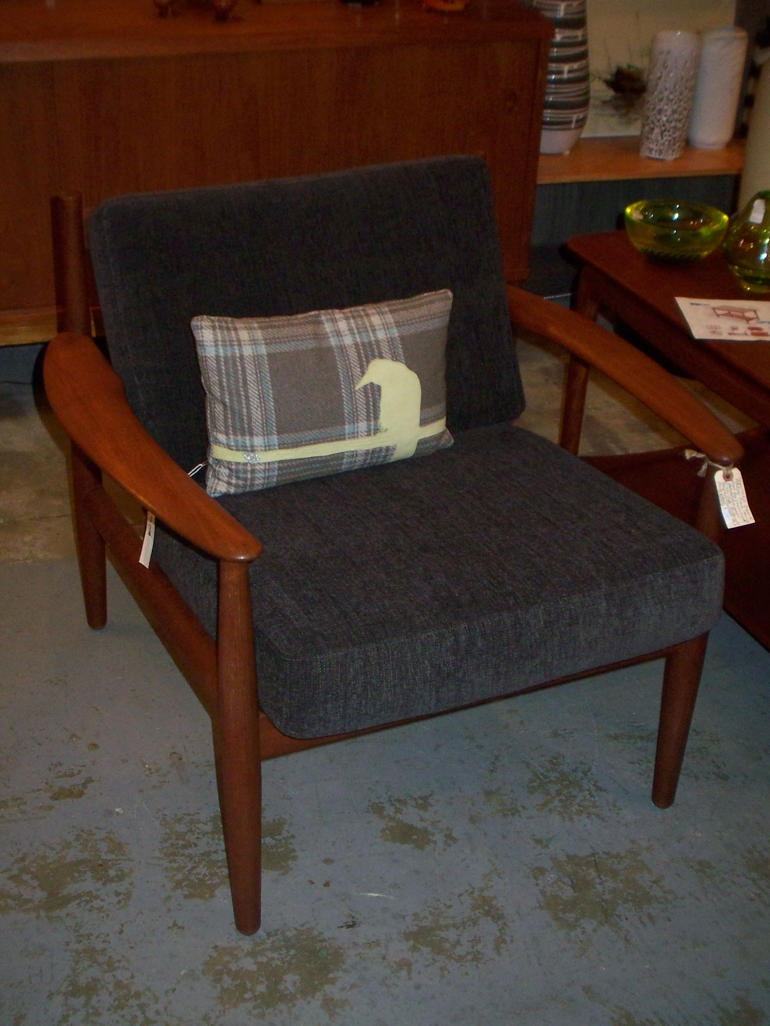I love chairs like these and the blue fabric looks fantastic with the orange tone of the teak. The gorgeous pillow with the applique is made by Oblong design.