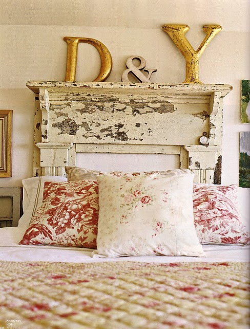Headboard made from vintage fireplace mantel. Paint it if you want a more refined look.