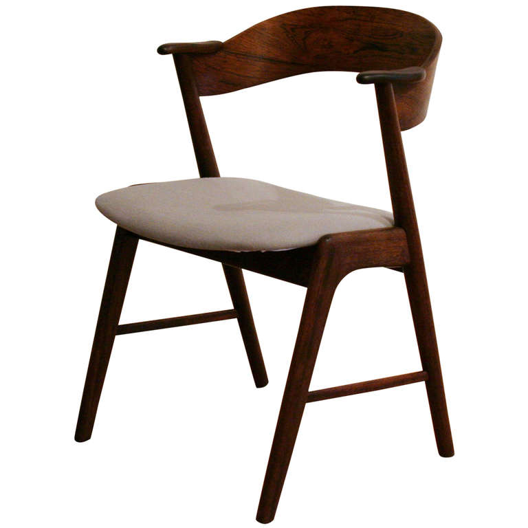 Kai Kristiansen chair (don't have the exact price but probably between $300-$500).
