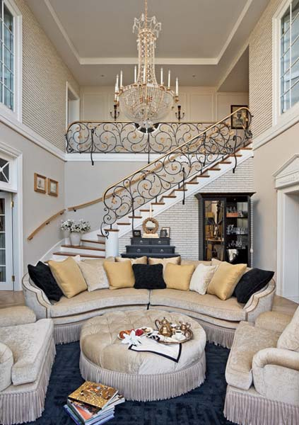 Spiral lines are most common in traditional design as shown here on the stair railing. The furniture in the living room also has good examples of curved lines.