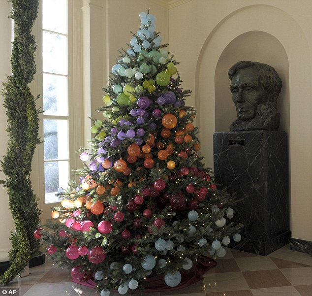 "Apparently this polychromatic tree was in the White House one year. I'm not sure but it looks like the ""ornaments"" are actually balloons. An interesting idea."