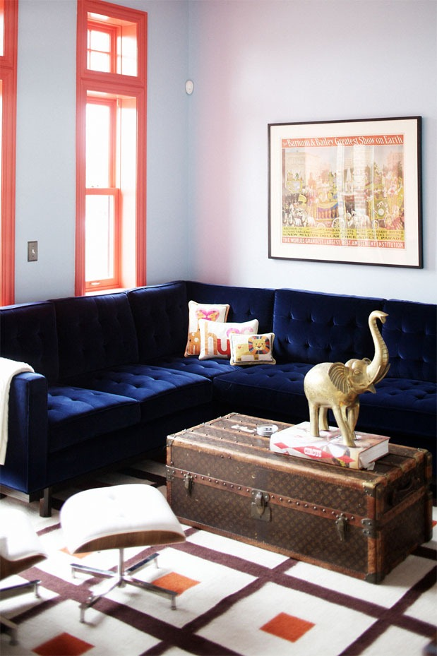 Painting the window frames: a funky and low cost way of introducing colour to a room. And that couch! Gorgeous.