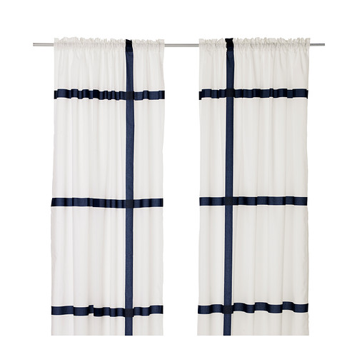 I'm not at all a fan of the shirred curtain top but love the bold indigo stripe.