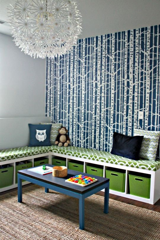 Two expedit bookshelves plus one fabulous bench cushion equals and envy worthy playroom (I want that wall paper!)
