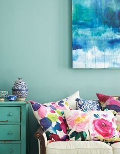 I think these pillows are stunning! And the colour of that wall, beautiful.
