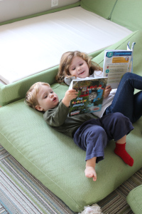 "Yesterday Sofia and Charlie spent like and hour ""reading"" together on our dismantled chaise."
