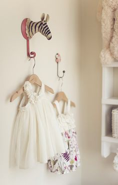 If your short on closet space why not display you finest as wall art. A perfect idea for a little girl's nursery.