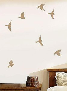 Stencils are always a great option but not everyone is cut out for the work involved in a full wall stencil. Some simple stencilled birds can add a whimsical touch and is easier (and much cheaper- $20ish) than a full wall stencil.