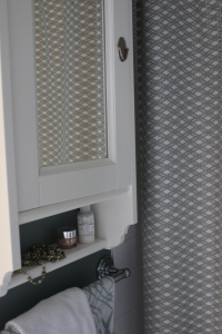 Snagged Ikea cabinet;  custom shower curtain with Robert Allen fabric.