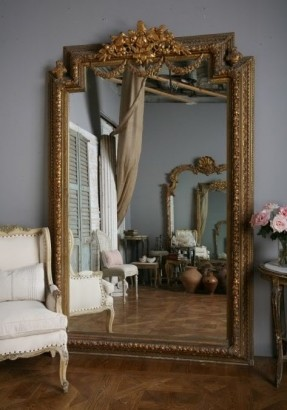 This oversized mirror visually enlarges this room.