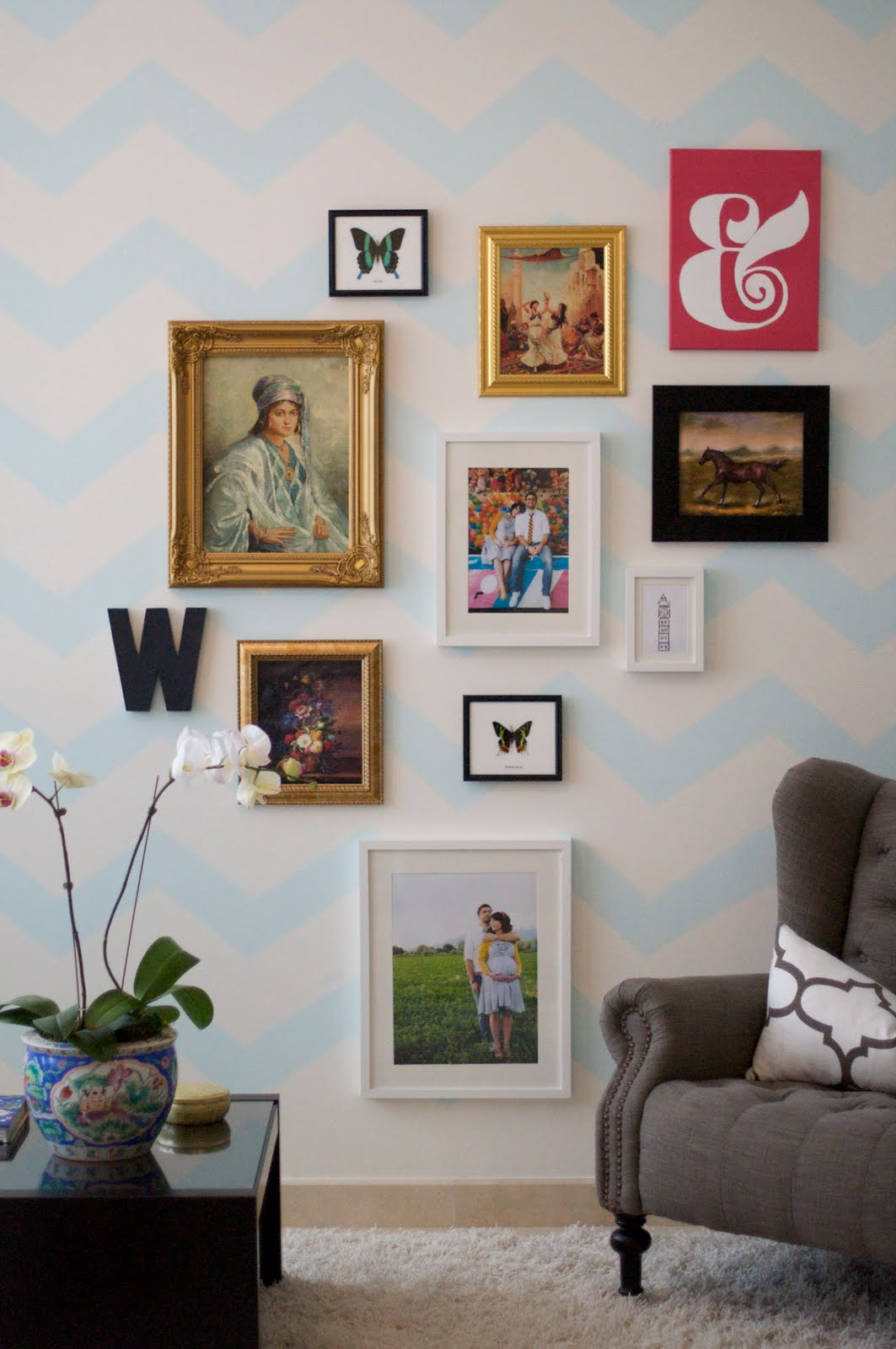 It is fine to mix frames, add mirrors, antlers, letters etc. but keep that straight line. The straight line formed on the right side of this picture with the two prints helps to anchor this arrangment.